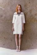 Белое кружевное платье с черным бантиком Valentino