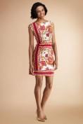 Белое летнее платье с ярким оранжевым принтом Emilio Pucci